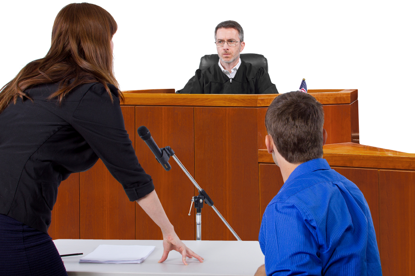 Defendant with lawyer speaking to a judge in the courtroom image