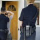 Police Officer Arresting Man at a Typical drug bust at a residential property image